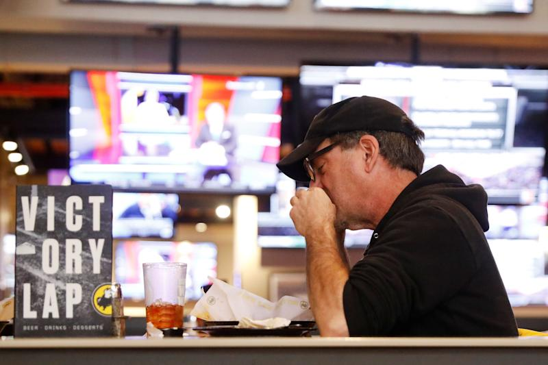 A man eats inside of a Buffalo Wild Wings restaurant in New York, U.S., February 6, 2017. REUTERS/Lucas Jackson
