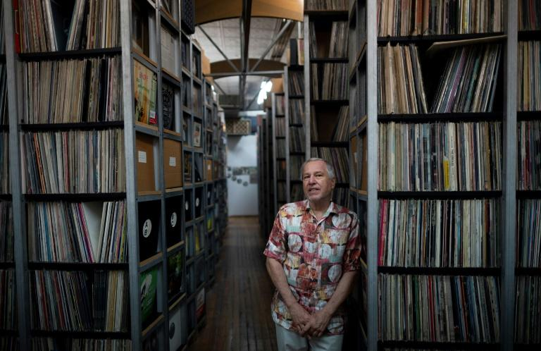 B. George, the Co-Founder and Director of the ARChive of Contemporary Music in front of the institution's vast collection that includes some 3 million recordings