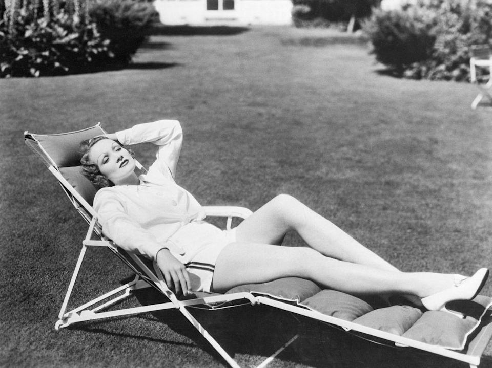 <p>The German seductress relaxes in a lawn chair in a top-notch ensemble: a sweater, play shorts, and sky-high pumps. <br></p>