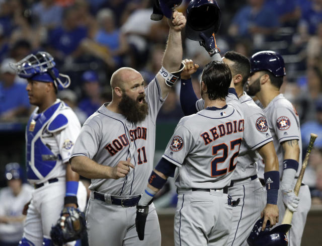 Houston Astros designated hitter Evan Gattis (11) celebrates his grand slam with teammates during the sixth inning of a baseball game against the Kansas City Royals at Kauffman Stadium in Kansas City, Mo., Friday, June 15, 2018. (AP Photo/Orlin Wagner)