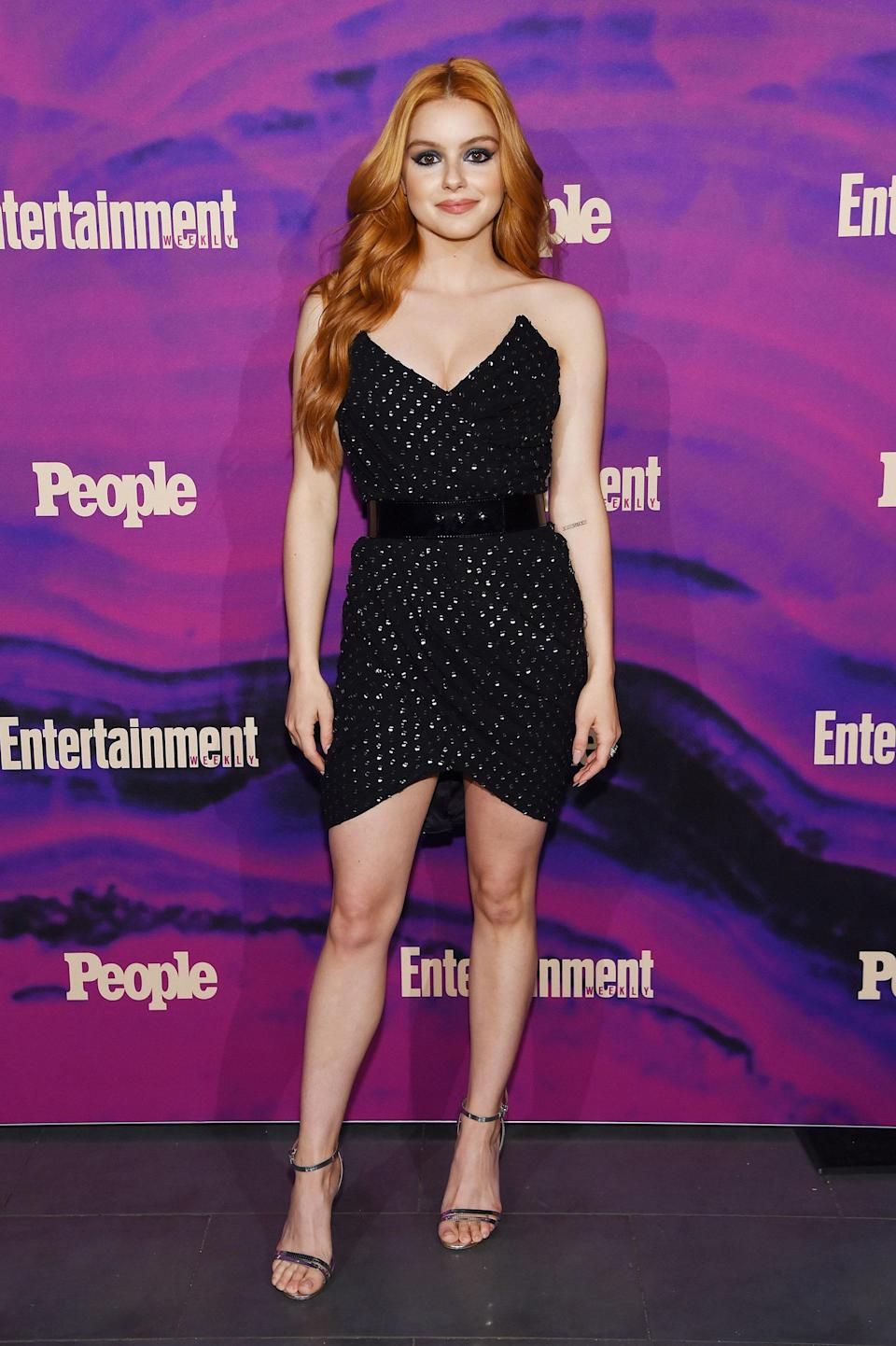 We can't get enough of Ariel's red hair and sparkly black dress.