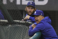 Los Angeles Dodgers manager Dave Roberts and starting pitcher Clayton Kershaw watch batting practice before Game 2 of the baseball World Series against the Tampa Bay Rays Wednesday, Oct. 21, 2020, in Arlington, Texas. (AP Photo/Sue Ogrocki)