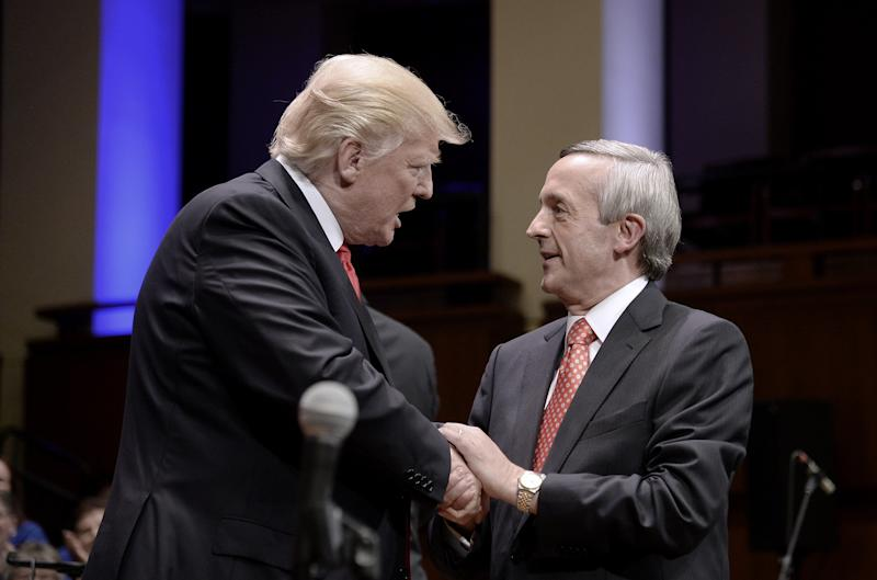 President Donald Trump is greeted by Pastor Robert Jeffress during a rally on July 1, 2017, in Washington, D.C. (Pool via Getty Images)