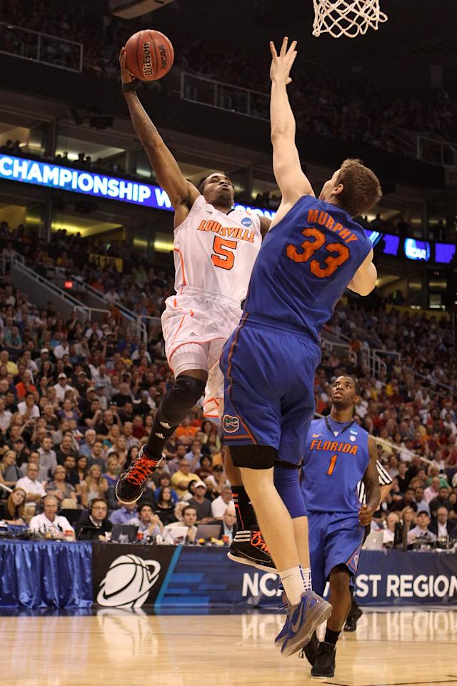 PHOENIX, AZ - MARCH 24:  Chris Smith #5 of the Louisville Cardinals goes up for a shot over Erik Murphy #33 of the Florida Gators in the second half during the 2012 NCAA Men's Basketball West Regional Final at US Airways Center on March 24, 2012 in Phoenix, Arizona.  (Photo by Christian Petersen/Getty Images)