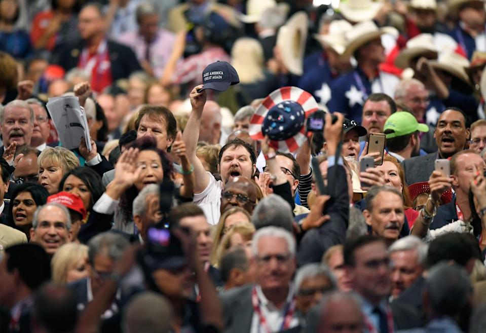 <p>Delegates react as some delegates call for a roll call vote on the adoption of the rules during the opening day of the Republican National Convention in Cleveland, Monday, July 18, 2016. (AP Photo/Mark J. Terrill)</p>