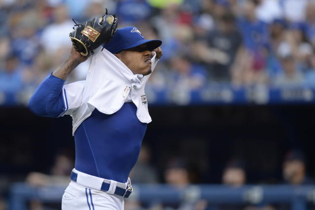 Toronto Blue Jays starting pitcher Marcus Stroman (6) takes off his jersey as he walks towards the dugout after the third inning of a baseball game against the Cleveland Indians, Wednesday, July 24, 2019 in Toronto. (Nathan Denette/Canadian Press via AP)