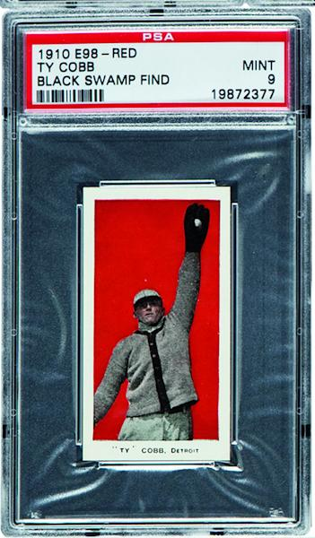 This undated photo provided by Heritage Auctions of Dallas, shows a 1910 E98 Ty Cobb baseball card found in the attic of a house in Defiance, Ohio with about 700 others. The best of the bunch _ 37 cards _ are expected to bring a total of $500,000 when they are sold at auction in August during the National Sports Collectors Convention in Baltimore. (AP Photo/ Heritage Auctions)