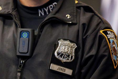 FILE PHOTO - A police body camera is seen on officer during news conference on pilot program at NYPD police academy in the Queens borough of New York