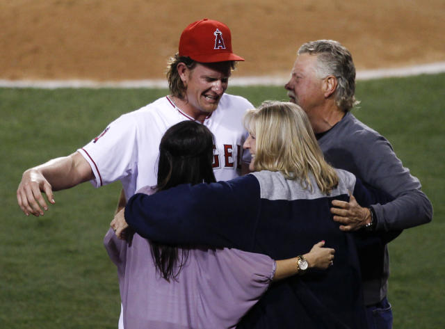Los Angeles Angels starting pitcher Jered Weaver celebrates his no hitter against the Minnesota Twins with his wife, Kristin and mother Gail and father Dave at a baseball game in Anaheim, Calif., Wednesday, May 2, 2012. (AP Photo/Chris Carlson)