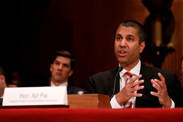 FILE PHOTO: Ajit Pai Chairman of the Federal Communications Commission testifies on Capitol Hill in Washington
