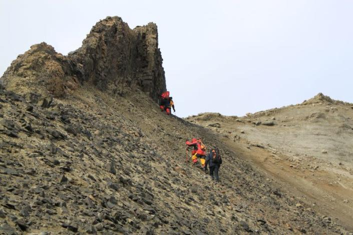 People hike during an expedition on Seymour Island in Antarctica
