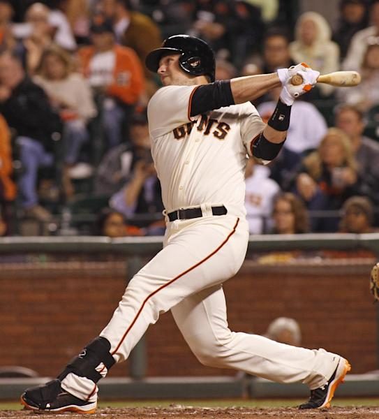 San Francisco Giants' Buster Posey hits a two RBI double against the Miami Marlins during the fifth inning of a baseball game, Thursday, May 15, 2014, in San Francisco. (AP Photo/George Nikitin)