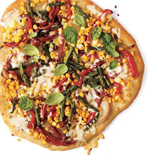 """<p>Using store-bought pizza dough is a lifesaver when dinners have to be quick. These vegetable toppings use the very best of the season with fresh bell pepper, corn, and basil. It's simply good.</p> <p> <a rel=""""nofollow noopener"""" href=""""http://www.myrecipes.com/recipe/summer-veggie-pizza"""" target=""""_blank"""" data-ylk=""""slk:View Recipe: Summer Veggie Pizza"""" class=""""link rapid-noclick-resp"""">View Recipe: Summer Veggie Pizza</a></p>"""