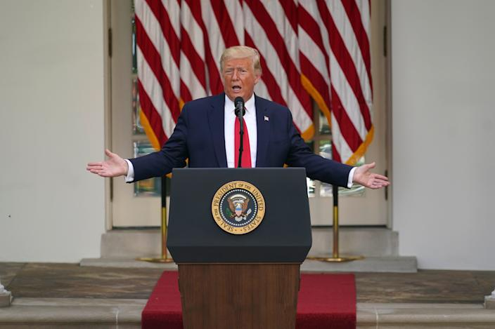 President Donald Trump answers questions from reporters during an event on protecting seniors with diabetes in the Rose Garden White House, May 26, 2020, in Washington.