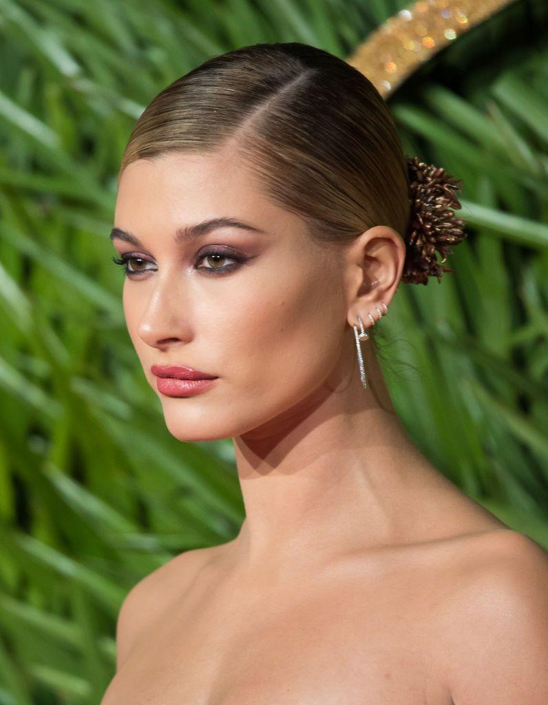 <p>A sophisticated smokey eye is so beautiful for an evening wedding! Creating the look with a brown or purple-toned shadow like Hailey Bieber did—as opposed to black—gives the look softness.</p>