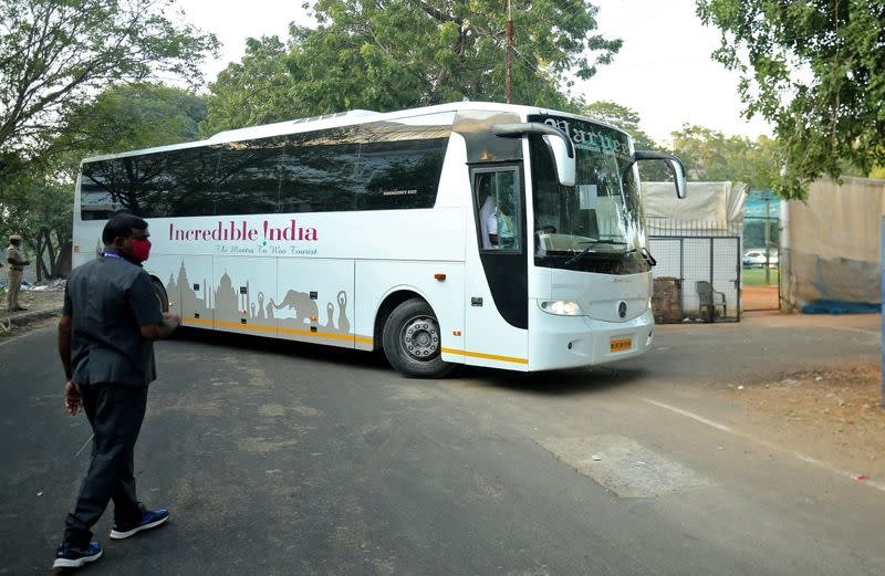 A bus carrying England's team members enters a stadium to play their first test cricket match against India, in Chennai