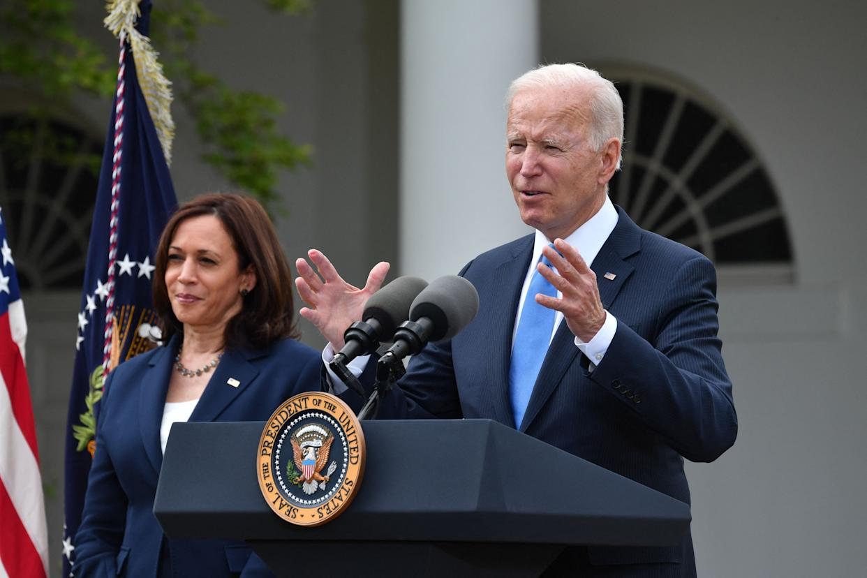 US Vice President Kamala Harris looks on as US President Joe Biden delivers remarks on Covid-19 response and the vaccination program, from the Rose Garden of the White House, Washington, DC on May 13, 2021. (Photo by Nicholas Kamm / AFP) (Photo by NICHOLAS KAMM/AFP via Getty Images)