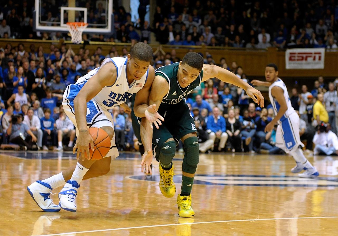 DURHAM, NC - DECEMBER 28: Andre Dawkins #34 of the Duke Blue Devils forces a turnover by Karrington Ward #14 of the Eastern Michigan Eagles during their game at Cameron Indoor Stadium on December 28, 2013 in Durham, North Carolina. Duke won 82-59. (Photo by Grant Halverson/Getty Images)
