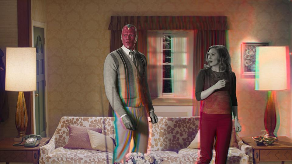"Vision (Paul Bettany) and Wanda Maximoff (Elizabeth Olsen) notice some weird things happening around them in ""WandaVision."""