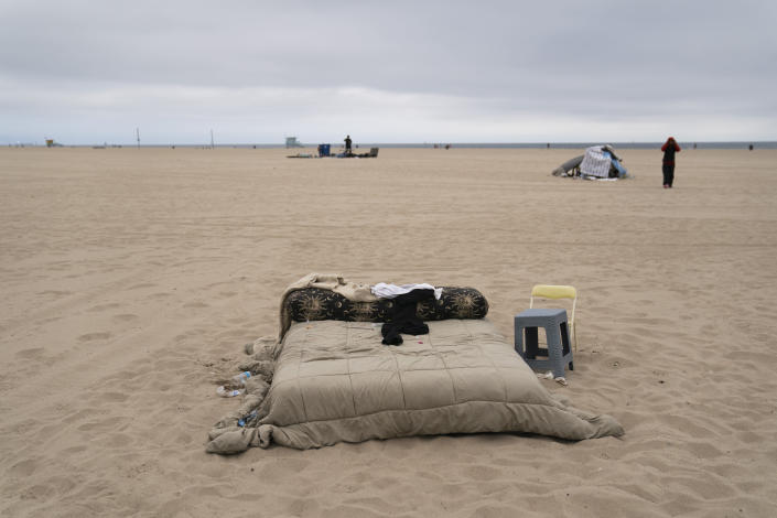 A homeless person's mattress and belongings sit on the beach in the Venice neighborhood of Los Angeles, Tuesday, June 29, 2021. The proliferation of homeless encampments on Venice Beach has sparked an outcry from residents and created a political spat among Los Angeles leaders. (AP Photo/Jae C. Hong)
