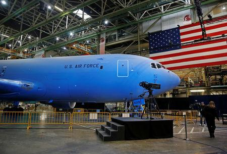 The Boeing KC-46 Pegasus aerial refueling tanker is bathed in blue light before a delivery celebration to the U.S. Air Force in Everett, Washington
