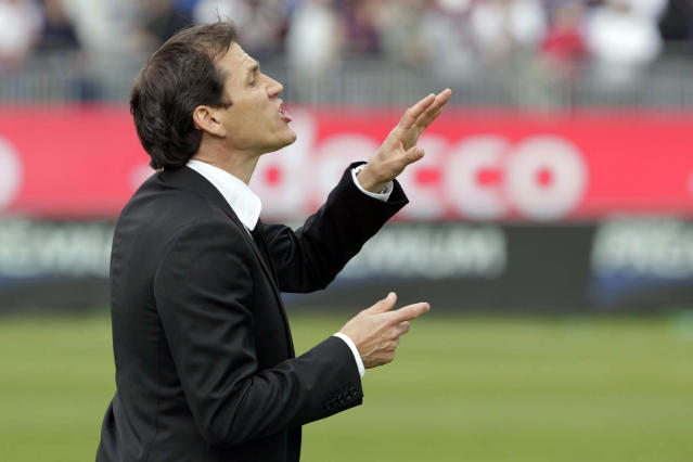Roma coach Rudy Garcia gives indications to his players during a Serie A soccer match between Cagliari and Roma in Cagliari, Italy, Sunday, April 6, 2014. Roma moved within five points of Serie A leader Juventus as Mattia Destro scored his first-ever hat trick in a 3-1 win at Cagliari on Sunday. (AP Photo/Max Solinas)