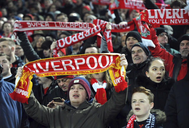 "FILE - In this Feb. 11, 2017 file photo, Liverpool fans at the Kop sing ""You'll Never Walk Alone"" during the English Premier League soccer match between Liverpool and Tottenham Hotspur at Anfield, Liverpool, England. The famous tune will be sung Saturday by 16,000-plus Liverpool fans at Olympic Stadium in Kiev, Ukraine. (AP Photo/Rui Vieira, File)"
