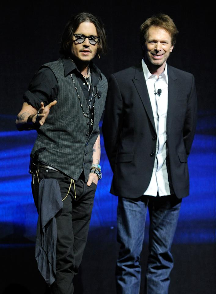"LAS VEGAS, NV - APRIL 24:  Actor Johnny Depp (L) and producer Jerry Bruckheimer speak at a Walt Disney Studios Motion Pictures presentation to promote their upcoming film, ""The Lone Ranger"" at The Colosseum at Caesars Palace during CinemaCon, the official convention of the National Association of Theatre Owners, April 24, 2012 in Las Vegas, Nevada.  (Photo by Ethan Miller/Getty Images)"