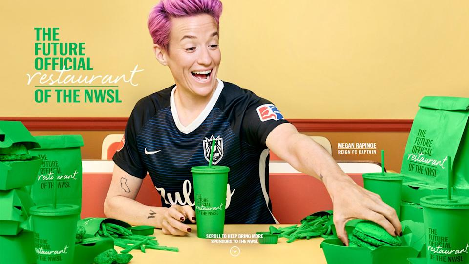 Megan Rapinoe consumes fast food and and sports a watch as part of Budweiser's tongue-in-cheek ad campaign promoting the NWSL. (Via Budweiser)