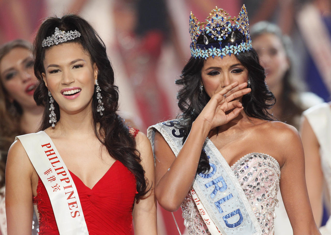 Miss Venezuela Ivian Sarcos reacts as she is crowned winner, Miss Philippines Gwendoline Ruais, left, was second at the Miss World competition held at Earls Court in London, Sunday, Nov. 6, 2011. (AP Photo/Kirsty Wigglesworth)
