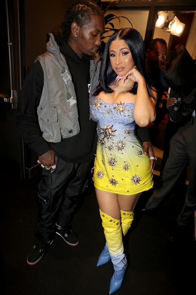 <p>Cardi styled a Fausto Puglisi dress with matching over-the-knee boots, and Offset kept it casual in sport pants, a hoodie, and a gray vest.</p>