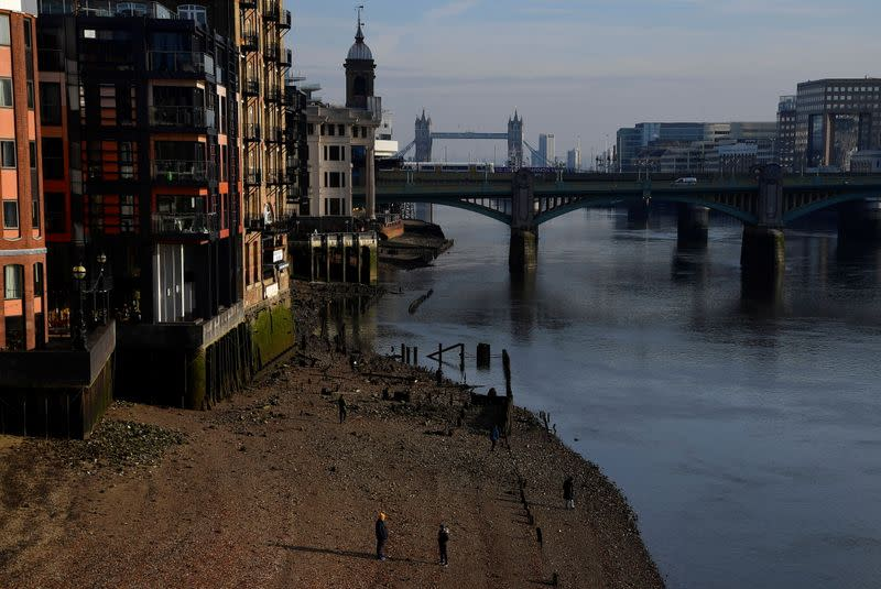 People exercise beside the River Thames amidst the COVID-19 pandemic, London, Britain