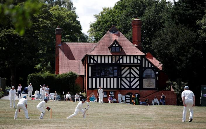 Members of the Tilford Cricket Club play an inter club match, on the first weekend that recreational cricket is allowed to be played in England since lockdown - Reuters