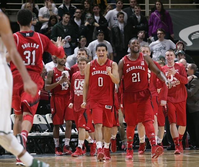 Nebraska players, including Shavon Shields (31), Tai Webster (0) and Leslee Smith (21 celebrate their 60-51 win over Michigan State in an NCAA college basketball game, Sunday, Feb. 16, 2014, in East Lansing, Mich. (AP Photo/Al Goldis)