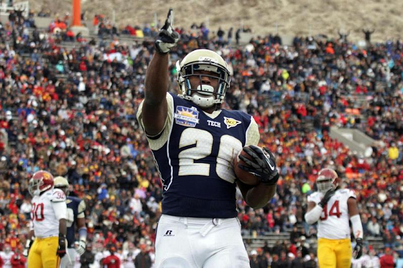 Georgia Tech running back David Sims celebrates his touchdown against Southern California during the first half of the Sun Bowl NCAA college football game, Monday, Dec. 31, 2012, in El Paso, Texas. (AP Photo/Mark Lambie)