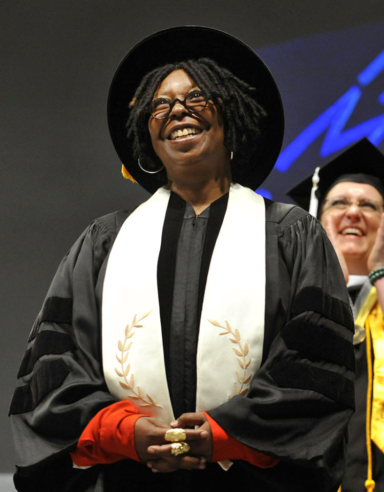 "<p class=""MsoNormal""><span style=""mso-fareast-font-family: 'Times New Roman'; mso-bidi-font-family: 'Times New Roman';"">Funny gal Whoopi Goldberg knows graduating from college is no joke, but she couldn't help but crack a smile after seeing one grad's hat, which read, ""Hire Me,"" at the 2011 commencement ceremony for the Savannah College of Art And Design. (6/4/2011)</span></p> <p class=""MsoNormal""><span style=""mso-fareast-font-family: 'Times New Roman'; mso-bidi-font-family: 'Times New Roman';""><span style=""mso-spacerun: yes;""> </span></span></p>"