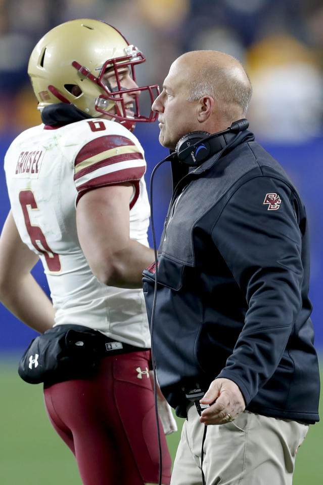 FILE - In this Nov. 30, 2019, file Boston College head coach Steve Addazio, right, greets quarterback Dennis Grosel (6) during an NCAA college football game, in Pittsburgh. Boston College fired Addazio on Sunday, Dec. 1, after seven seasons in which the Eagles never surpassed seven wins. Addazio was 44-44 since taking over in 2013. (AP Photo/Keith Srakocic, File)
