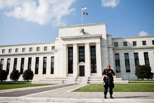 Fed hold rates low after economy 'paused'