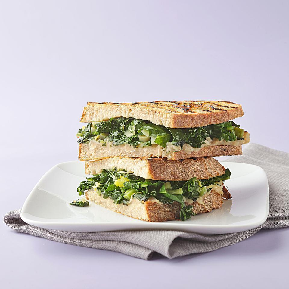 """<p>A creamy spread of cannellini beans cooked with onion, garlic and white wine is the perfect match for tender braised greens. Press the two between pieces of crusty whole-wheat bread and you have an outstanding vegan panini. <a href=""""https://www.eatingwell.com/recipe/250439/braised-greens-cannellini-bean-panini/"""" rel=""""nofollow noopener"""" target=""""_blank"""" data-ylk=""""slk:View Recipe"""" class=""""link rapid-noclick-resp"""">View Recipe</a></p>"""