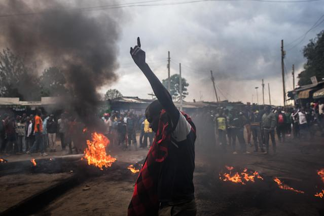 <p>Opposition supporters burn tires in protest for presidential candidate Raila Odinga, in the Kibera slum on Oct. 25, 2017 in Nairobi, Kenya. (Photo: Andrew Renneisen/Getty Images) </p>