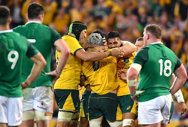 Rugby Union - June Internationals - Australia vs Ireland - Lang Park, Brisbane, Australia - June 9, 2018 - David Pocock of Australia celebrates with team mates after scoring a try. AAP/Darren England/via REUTERS ATTENTION EDITORS - THIS IMAGE WAS PROVIDED BY A THIRD PARTY. NO RESALES. NO ARCHIVE. AUSTRALIA OUT. NEW ZEALAND OUT.