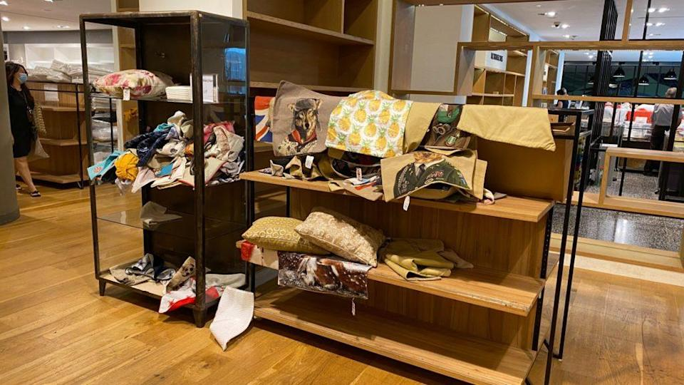 Unfolded Pillowcases laid out in a mess on shelves at The Heeren outlet. Photo: Coconuts