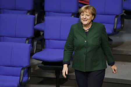 German Chancellor Angela Merkel attends a meeting at the lower house of parliament Bundestag on 2017 budget in Berlin, Germany, November 23, 2016. REUTERS/Fabrizio Bensch
