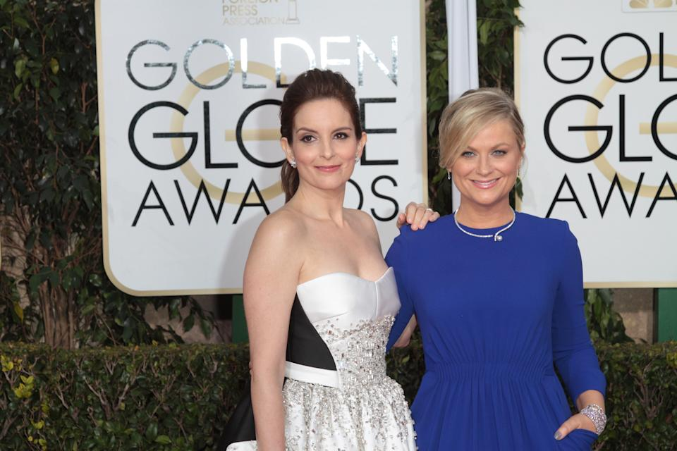 Actress and Co-Host Tina Fey and Amy Poehler arrive at the 72nd Annual Golden Globe Awards held at the Beverly Hilton Hotel in Los Angeles, CA on January 11, 2015. (Photo By Adam Orchon) *** Please Use Credit from Credit Field ***