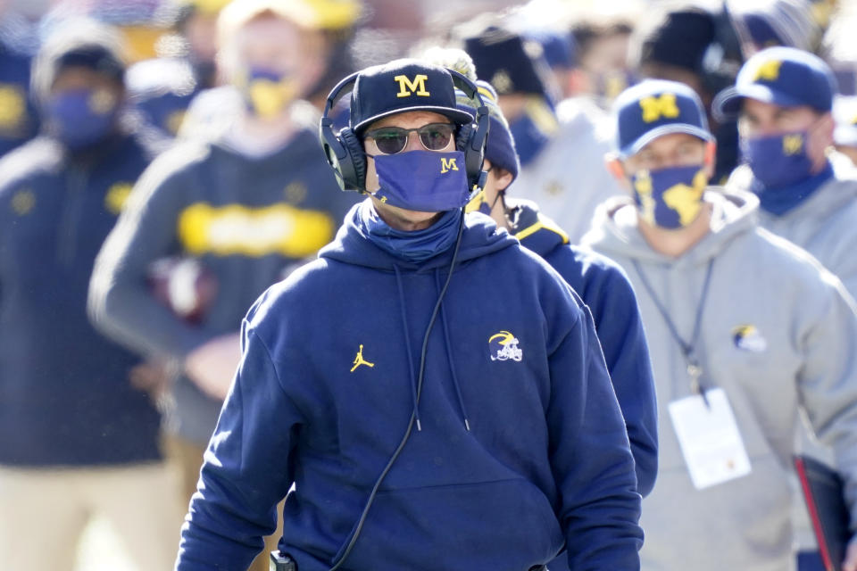 Michigan head coach Jim Harbaugh is seen during the first half of an NCAA college football game, Saturday, Oct. 31, 2020, in Ann Arbor, Mich. (AP Photo/Carlos Osorio)