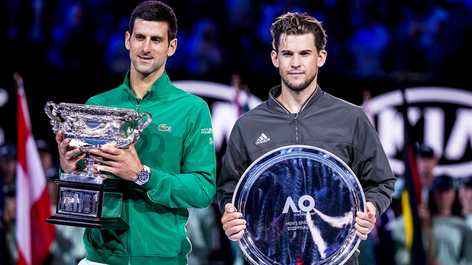 Dominic Thiem is pictured to the right of Novak Djokovic, who he was runner-up to at the 2020 Australian Open.