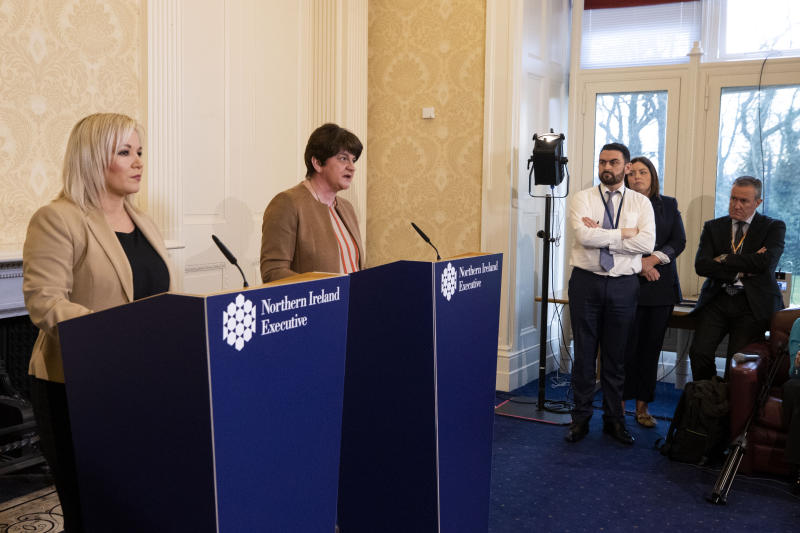 First Minster Arlene Foster (second from left) and Deputy First Minister Michelle OÕNeill (left) hold a joint press conference at Stormont Castle in Belfast to give an update on plans to tackle Coronavirus and announce school closures on Friday. (Photo by Liam McBurney/PA Images via Getty Images)