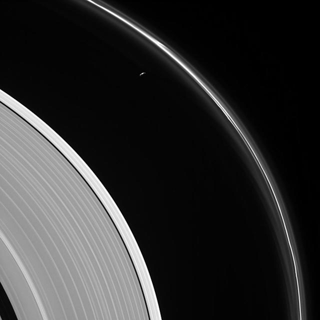 <p>The thin sliver of Saturn's moon Prometheus lurks near ghostly structures in Saturn's narrow F ring in this view from NASA's Cassini spacecraft on May 13, 2017. Many of the narrow ring's faint and wispy features result from its gravitational interactions with Prometheus (86 kilometers, or 53 miles across). (Photo: NASA/JPL-Caltech/Space Science Institute) </p>