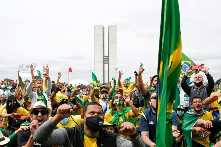 People take part in a demonstration to show their support for Brazilian President Jair Bolsonaro amid the COVID-19 novel coronavirus disease pandemic, in Brasilia, on May 1, 2021
