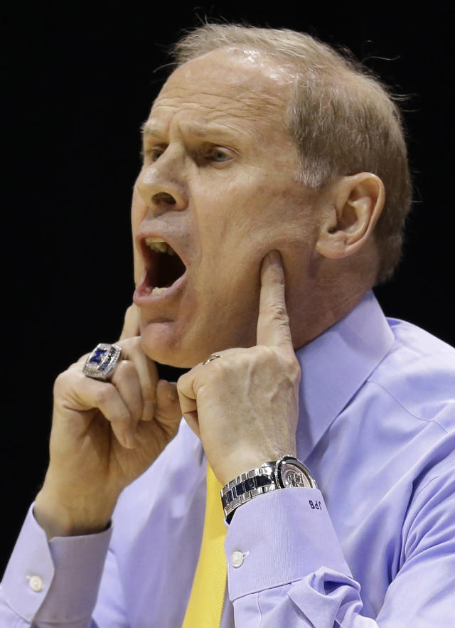 Michigan head coach John Beilein reacts during the first half of an NCAA Midwest Regional semifinal college basketball tournament game against the Tennessee Friday, March 28, 2014, in Indianapolis. (AP Photo/Michael Conroy)